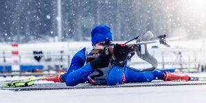Biathlon training during winter blizzard.