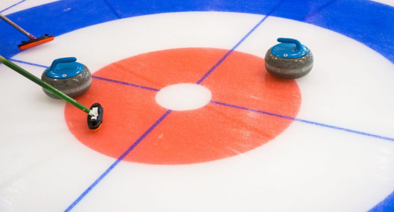 Curling,Stones,Equipment,On,The,Ice