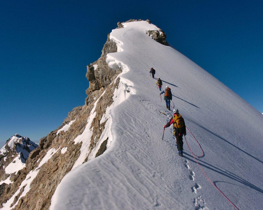 Tied,Climbers,Climbing,Mountain,With,Snow,Field,Tied,With,A